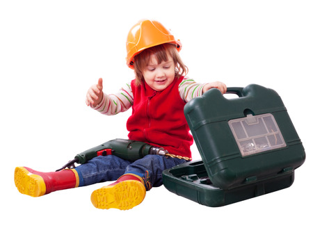 hardhat: Little builder in hardhat with tool. Isolated over white background Stock Photo