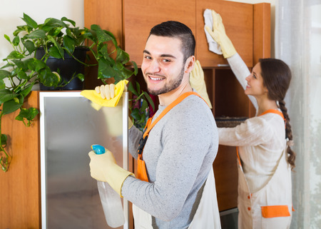 cleaning team: Cleaning premises team working at clients home. Focus on man Stock Photo