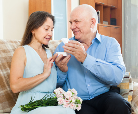 jewel box: Mature man giving  woman the  jewel box  at home