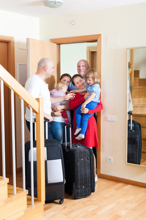 relatives: Happy family with children seeing off the relatives to home Stock Photo