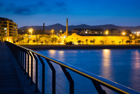 fabrica: Pier at beach of Badalona  in evening time.  Spain