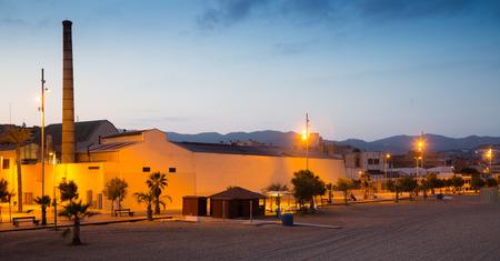 fabrica: Embankment at Badalona in twilight. Catalonia, Spain Stock Photo
