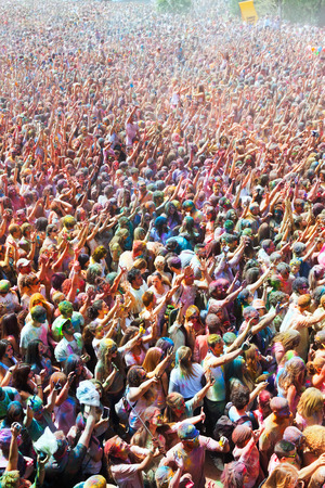 colores: BARCELONA, SPAIN - APRIL 12, 2015: Many happy dirty people at Festival de los colores Holy at Barcelona. It is traditional holiday  of Indian culture