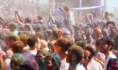 colores: BARCELONA, SPAIN - APRIL 6, 2014: Crowd of people at IV Festival de los colores Holi in Barcelona. Holi is traditional holiday of India