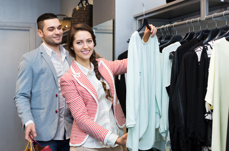 spouses: Positive young spouses while shopping at boutique