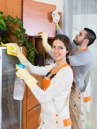 company premises: Professional cleaners with equipment standing of client house
