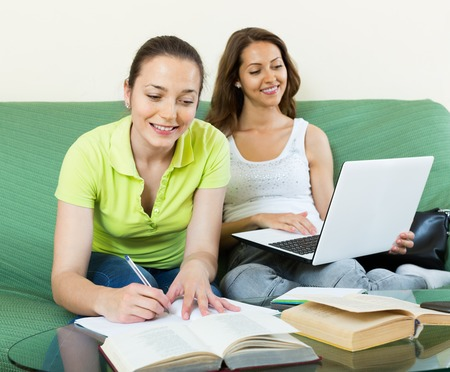 kindred: Two young girls studying in home Stock Photo