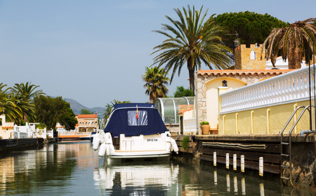 navigable: EMPURIABRAVA, SPAIN - MAY 14, 2015: Canals of Empuriabrava. Empuriabrava  is  largest residential marina in Europe with some 24 km of navigable canals