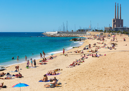 3rd century: BADALONA, SPAIN - MAY 23, 2015: Mediterranean sand beach in Badalona, Spain.  City was founded by  Romans in the 3rd century BC. Now it is one of the centers of a beach holiday in Europe Editorial