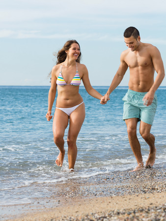 newly married couple: Happy smiling newly married couple having fun at the beach in honeymoon Stock Photo
