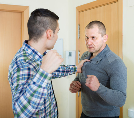 family fight: Family fight between two quarreling brothers at home