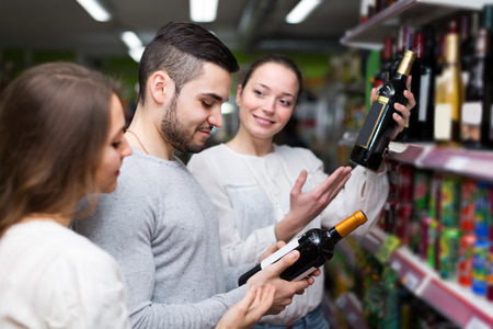 Positive   people 30 years old buying beverages for dinner at food shop photo