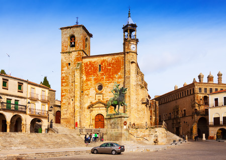 TRUJILLO, SPAIN - NOVEMBER 18, 2014: Day view of Church and  statue of Francisco Pizarro at  Plaza Mayor. Trujillo, Spain