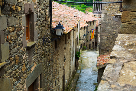 olden day: picturesque street  in catalan town. Rupit i Pruit, Spain