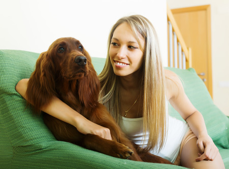 irish woman: Happy woman communicating with Irish setter at home Stock Photo
