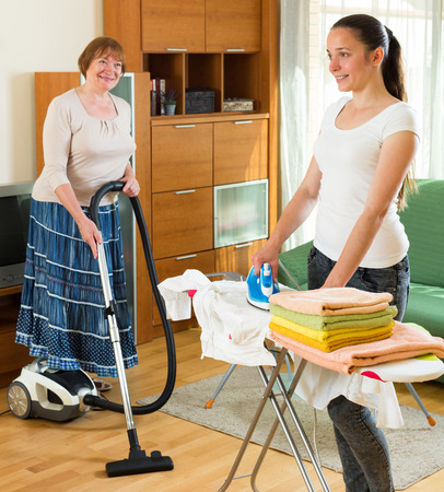 clean home: Two adult women clean at home together