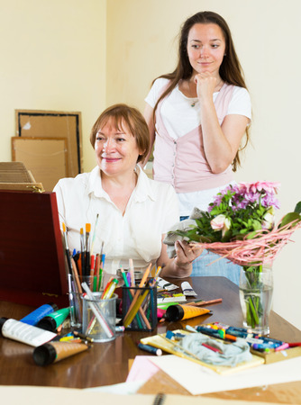admirer: Mature woman paints a picture for her admirer