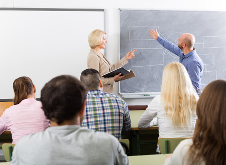 attentive: Attentive adult students with female teacher at training session for employees