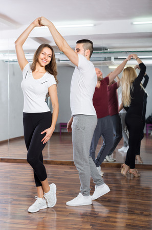 ballroom dancing: Happy young people having dancing and choreography class indoors Stock Photo