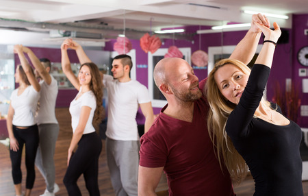 latin dancing: Happy young people having latin dancing  class indoors