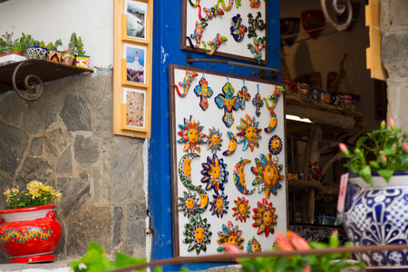 pablo picasso: CADAQUES, SPAIN - MAY 14, 2015:  Cadaques souvenirs at counter in store. Catalonia, Spain