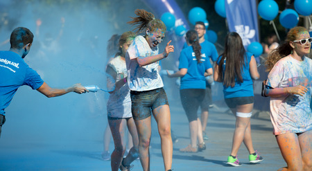 dirty girl: BARCELONA, SPAIN - JUNE 7, 2015: Happy dirty girl during   Festival The Color Run in Barcelona