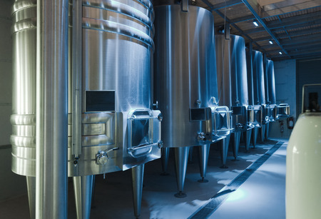 stell: Row of contemporary  large stell barrels in winemaker