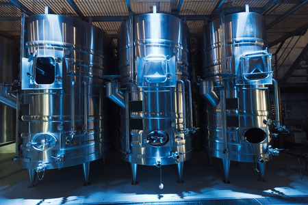 stell: Modern stell barrels in interior of contemporary winemaker factory Stock Photo