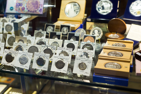numismatics: BARCELONA, SPAIN - OCTOBER 28, 2014: Collection of old  coins on counter at numismatics store