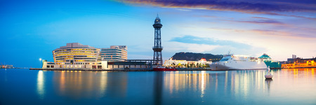 Panoramic view of Port Vell with liner in evening. Barcelona