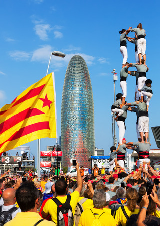 demanding: BARCELONA, SPAIN - SEPTEMBER 11, 2014: Castellers in Barcelona, Spain. Rally demanding independence for Catalonia Editorial