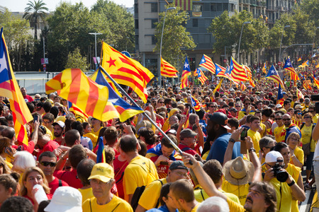 converge: BARCELONA, SPAIN - SEPTEMBER 11, 2014: People  at  National Day of Catalonia in Barcelona, Spain Editorial