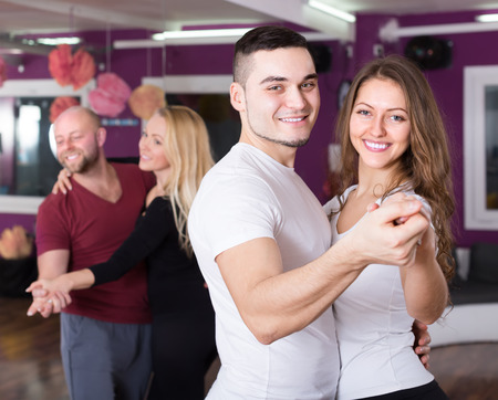 unprofessional: Two smiling couples having dancing class in club