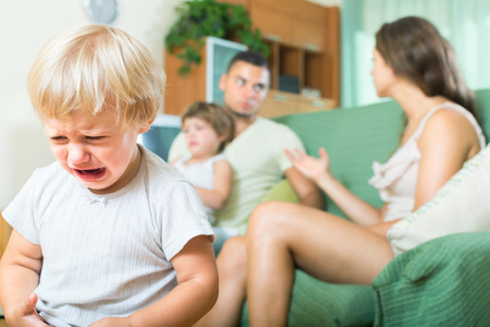 child stress: Little child crying due to a quarrel of parents Stock Photo