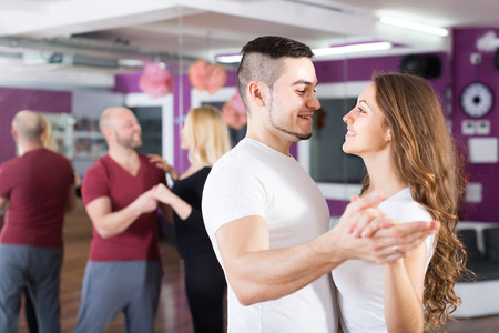 dancing club: Two happy smiling loving couples having dancing class in club