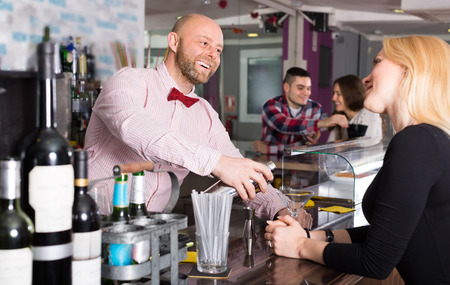 restaurant staff: Group of cheerful positive young adults hanging out in bar