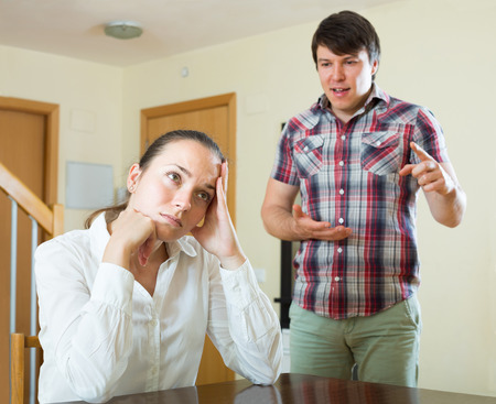 squabble: spanish woman having problems with her husband at home Stock Photo