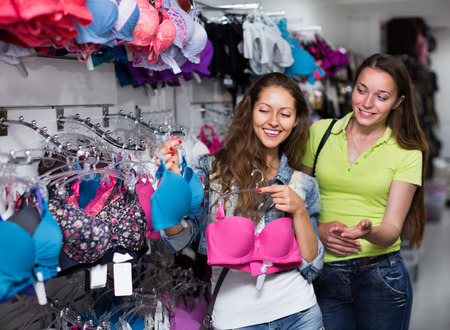 brassiere: Young attractive woman buying brassiere at the clothing store