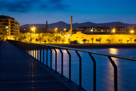fabrica: Pier at beach of Badalona  in evening. Catalonia, Spain
