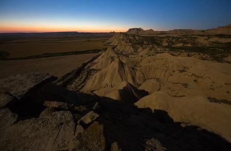 navarra: desert landscape of bardenas reales natural park in   moonlit night. Navarra, Spain