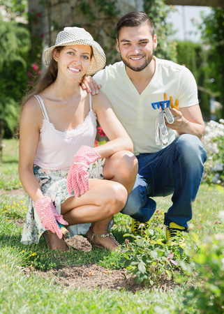 horticultural: Happy family in garden with horticultural sundry for planting flowers