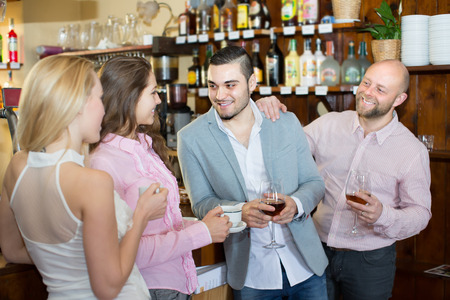 acquaintance: Casual acquaintance of attractive smiling young adults at bar. Selective focus