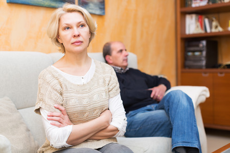 relationship problems: Family quarrel. Upset mature woman against elderly man at home