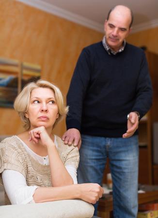 flatter: Guilty senior husband asking wife for forgiveness