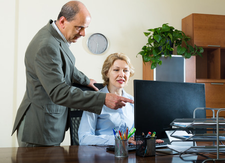 mistake: Office manager scolding elderly secretary for mistake