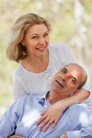 spaniard: Portrait of happy mature couple at summer park Stock Photo