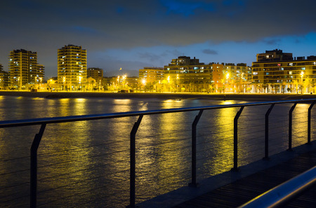 fabrica: Pier at beach of Badalona  in evening  time. Catalonia, Spain Stock Photo