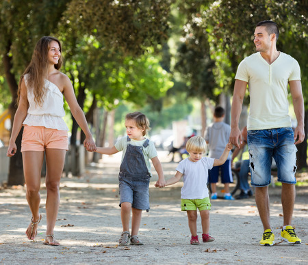 childrens playing: Happy family with childrens playing at park Stock Photo