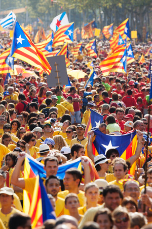 converge: BARCELONA, SPAIN - SEPTEMBER 11, 2014: People at rally demanding independence for Catalonia. Barcelona, Spain