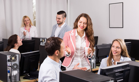 dealing: Employees and manager celebrating good dealing. Focus on the woman Stock Photo
